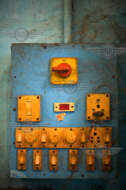 A control panel of switches for lighting in the S. Devasenapathy Sthapathy and Sons bronze casting workshop. The current Sthapathy generation is the twenty-third generation of bronze casters.