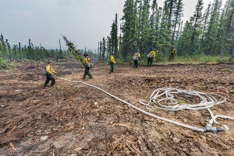 Firefighters work on prepping a controlled burn area on the Eagle Trail forest fire near Tok, Alaska, May, 2010.