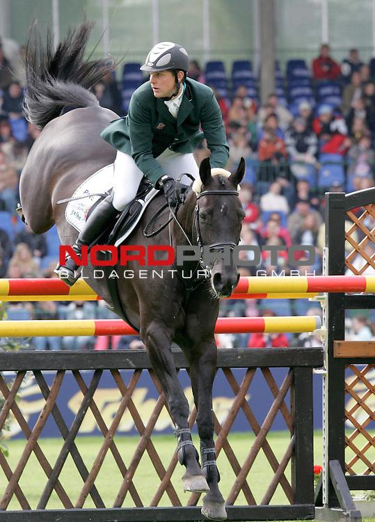 Deutsches Spring- und Dressur-Derby in Hamburg<br /> <br /> <br /> <br /> 2. Qualifikation zum Deutschen Spring-Derby<br /> <br /> Reiter Johannes Ehning (Deutschland) mit Pferd Olympia beim Sprung. Platz 2 in der Qualifikation.<br /> <br /> <br /> <br /> <br /> <br /> Foto &copy; nordphoto <br /> <br /> <br /> <br />  *** Local Caption ***