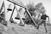- Friuli, due mesi dopo il terremoto del maggio 1976, militari dell'esercito tedesco suonano le campane durante una messa in memoria delle vittime....- Friuli, two months after the earthquake of May 1976, soldiers of German army  play the bells during a mass in memory of the victims ....