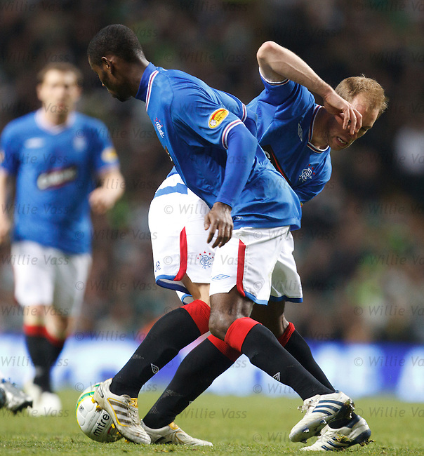 Steven Whittaker runs into Maurice Edu as they bothy try to clear the ball