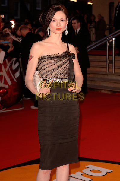 "SOPHIE ELLIS BEXTOR.Arriving at the 2007 ""Brit Awards"" at Earls Court, London, England, 14th February 2007..half length 3/4 black dress now hand on hip one strap shoulder.CAP/FIN.©Steve Finn/Capital Pictures."