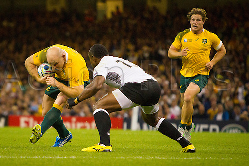 23.09.2015. Cardiff, Wales. Rugby World Cup. Australia versus Fiji. Stephen Moore of Australia attempts to break through Vereniki Goneva of Fiji.