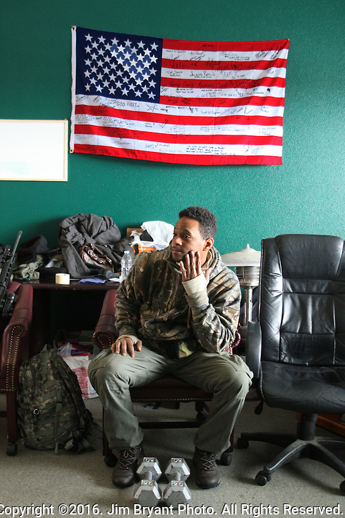 An activists relaxes in the Malheur National Wildlife Reserve's bunkhouse on January 16, 2016 in Burns, Oregon.  Ammon Bundy and about 20 other protesters took over the refuge on Jan. 2 after a rally to support the imprisoned local ranchers Dwight Hammond Jr., and his son, Steven Hammond.    ©2016. Jim Bryant Photo. All Rights Reserved.