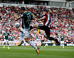 Enda Stevens of Sheffield Utd  tackles Henrik Dalsgaard of Brentford during the English Championship League match at Bramall Lane Stadium, Sheffield. Picture date: August 5th 2017. Pic credit should read: Simon Bellis/Sportimage