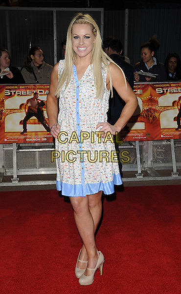 Chemmy Alcott .The 'StreetDance 2 3D' UK film premiere, Cineworld cinema, The O2 Arena, Millennium Way, London, England..March 19th, 2012.full length blue  print white trim dress hands on hips.CAP/CAN.©Can Nguyen/Capital Pictures.