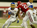 VERMILLION, SD - NOVEMBER 18: Isaac Wallace #35 from South Dakota State University looks for running room against the University of South Dakota during their game Saturday afternoon at the DakotaDome in Vermillion. (Photo by Dave Eggen/Inertia)