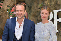 Rafe Spall and Elize Du Toit attends the 'The BFG' UK Premiere at the Odeon Leicester Square in London, England. 17th July 2016.<br /> CAP/JWP<br /> &copy;JWP/Capital Pictures /MediaPunch ***NORTH AND SOUTH AMERICAS ONLY***