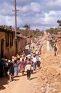 On February 4, 1976, Guatemala was struck by a 7.5 earthquake, which contributed to the high death toll of 23.000 and about 80.000 wounded. This happened during the night and most adobe type houses in mountain villages collapsed. The population migrated on foot from the destroyed villages to the cities and tried to resume their small business.