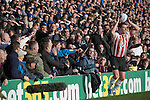 "Portsmouth 1 Southampton 1, 18/12/2012. Fratton Park, Championship. Portsmouth fans in the Fratton End stand at Fratton Park stadium barracking opposing full-back Frazer Richardson as their club take on local rivals Southampton in a Championship fixture. Around 3000 away fans were taken directly to the game in a fleet of buses in a police operation known as the ""coach bubble"" to avoid the possibility of disorder between rival fans. The match ended in a one-all draw watched by a near capacity crowd of 19,879. Photo by Colin McPherson."