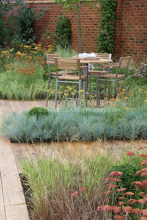 Backyard deck landscaping with wooden path garden plants for Tall grass garden plants