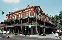 New Orleans:  Pontalba Buildings, 1849-50.  Architect  James Gallier, Sr.  Red brick, block-long 4 story building with shops below and apartments above.  National Historic Landmark.