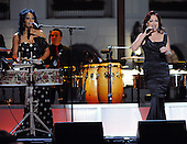 """Washington, DC - October 13, 2009 -- Gloria Estefan (R) and Sheila E. perform at a White House Music Series """"Fiesta Latina"""" with U.S. President Barack Obama on the South Lawn of the White House in Washington on Tuesday, October 13, 2009..Credit: Alexis C. Glenn / Pool via CNP"""