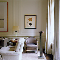 The living room features a framed work by Adolph Gottlieb, sculpture by Harry Bertoia and an Art Deco bergere