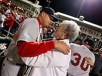 Manager Mike Shildt (8) of the Springfield Cardinals hugs his mother in the stands after game 3 of the Texas League Championship Series against the Frisco RoughRiders at Dr. Pepper BallPark on September 15, 2012 in Frisco, TX.  The Cardinals became the 2012 Texas League Champions after defeating the RoughRiders 2-1. (David Welker/Four Seam Images)