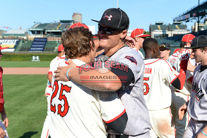 Chase Vallot (25) and Tyler Kolek (34) embrace after the Under Armour All-American Game on August 24, 2013 at Wrigley Field in Chicago, Illinois.  (Mike Janes/Four Seam Images)