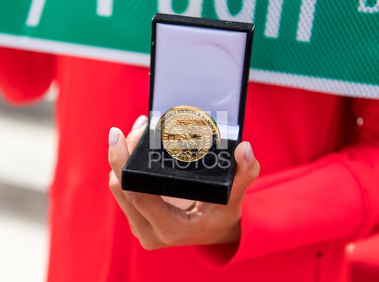 Denver, CO - April 3, 2019: Mallory Pugh and Lindsey Horan receive challenge coins from Denver Mayor Michael B. Hancock.