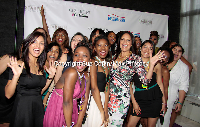 Soledad O'Brien poses with the girls at Soledad O'Brien and Brad Raymond Starfish Foundation presents New Orleans to New York City 2014 Gala on July 24, 2014 at Espace, New York City for VIP Cocktail Reception, dinner, entertainment with Grammy Award winning Trumpeteer Irvin Mayfield (also Board president) and the New Orleans Jazz Orchestra. (Photo by Sue Coflin/Max Photos)