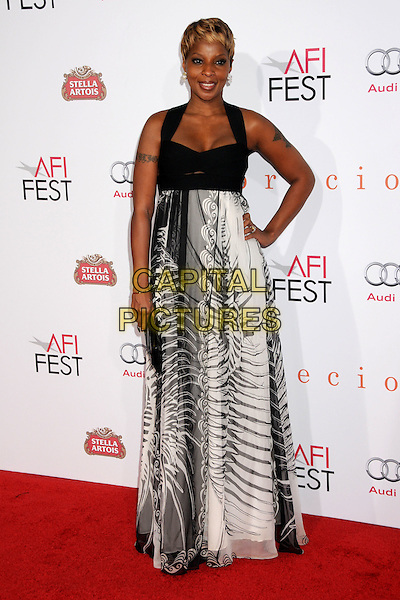 "MARY J. BLIGE .2009 AFI Film Festival Premiere of ""Precious"" held at Grauman's Chinese Theatre, Hollywood, California, USA,.1st November 2009..full length print dress long maxi hand on hip  black white tattoo clutch bag .CAP/ADM/BP.©Byron Purvis/Admedia/Capital Pictures"