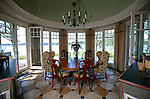 Breakfast nook off the kitchen with sweeping views of the Navesink River at the home of Pete and Judi Dawkins in Rumson, New Jersey. CREDIT: Bill Denver for the Wall Street Journal..NYHODRUMSON
