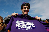 Andrew Christy poses for a photo with a Northwestern t-shirt in Wildcat Alley before the game against South Dakota