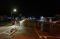 Pictured: Two young people by the flooded Pensarn Road in Carmarthen, Wales, UK. Saturday 13 October 2018<br /> Re: River Towy has burst its banks and adjacent properties have flooded, caused by storm Callum, in Carmarthen, west Wales, UK.