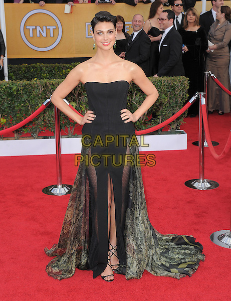 Morena Baccarin (Basil Soda).Arrivals at the 19th Annual Screen Actors Guild Awards at the Shrine Auditorium in Los Angeles, California, USA..27th January 2013.SAG SAGs full length black green sheer dress strapless slit split hands on hips floral fitted corset bodice mini peplum sheer panels.CAP/DVS.©DVS/Capital Pictures.