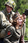 A young male and women WW2 soldiers reenactors