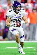 Indianapolis, IN - DEC 1, 2018: Northwestern Wildcats running back Isaiah Bowser (25) runs the football during first half action of the Big Ten Championship game between Northwestern and Ohio State at Lucas Oil Stadium in Indianapolis, IN. (Photo by Phillip Peters/Media Images International)
