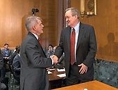 """United States Senator Mike Crapo, Chairman, US Senate Committee on Banking, Housing, and Urban Affairs, right, shakes hands withTimothy J. Sloan, Chief Executive Officer and President, Wells Fargo & Company, left, prior to hearing testimony at a hearing entitled, """"Wells Fargo: One Year Later"""" on Capitol Hill in Washington, DC on Tuesday, October 3, 2017. <br /> Credit: Ron Sachs / CNP"""
