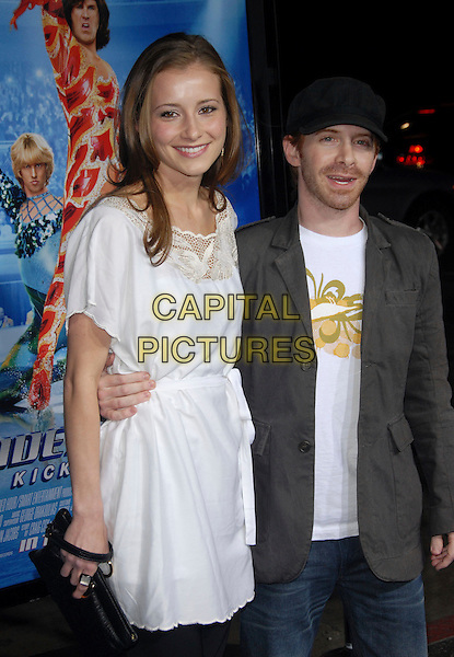 "CANDACE BAILEY & SETH GREEN.Attends The Paramount Pictures L.A. Premiere of ""Blades of Glory"" held at The Graumann's Chinese Theatre in Hollywood, California, USA. .March 28th, 2007.half length black hat couple white dress grey gray jacket .CAP/DVS.©Debbie VanStory/Capital Pictures"