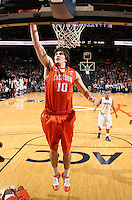 Feb. 2, 2011; Charlottesville, VA, USA; Clemson Tigers center Catalin Baciu (10) reaches for the rebound in front of Virginia Cavaliers guard Jontel Evans (1) during the game at the John Paul Jones Arena. Virginia won 49-47. Mandatory Credit: Andrew Shurtleff