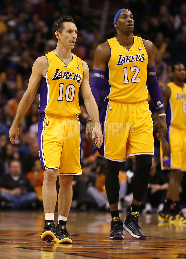 Jan. 30, 2013; Phoenix, AZ, USA: Los Angeles Lakers guard Steve Nash (10) and center Dwight Howard (12) against the Phoenix Suns at the US Airways Center. Mandatory Credit: Mark J. Rebilas-