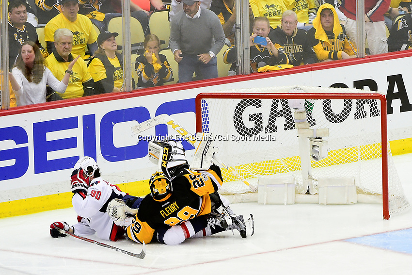 May 1, 2017: Pittsburgh Penguins goalie Marc-Andre Fleury (29) lands on Washington Capitals center Marcus Johansson (90)during game 3 of the second round of the National Hockey League Eastern Conference Stanley Cup Playoffs between the Washington Capitals and the Pittsburgh Penguins, held at PPG Paints Arena, in Pittsburgh, PA. Washington defeats Pittsburgh 3-2 in overtime. Pittsburgh leads Washington in the best of seven series 2-1. Eric Canha/CSM