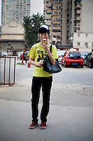 Wuzhenqiao, a student, age 19, poses for a portrait in Nanjing. Response to 'What does China mean to you?': 'The word China represents the holy name of my own great mother country. '  Response to 'What is China's role in the future?': 'In accordance with the modern demonstration of development, I believe China will become glorious to a large extent.'