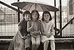 Williamsport, Pa, 1968. Three young girls with umbrella.