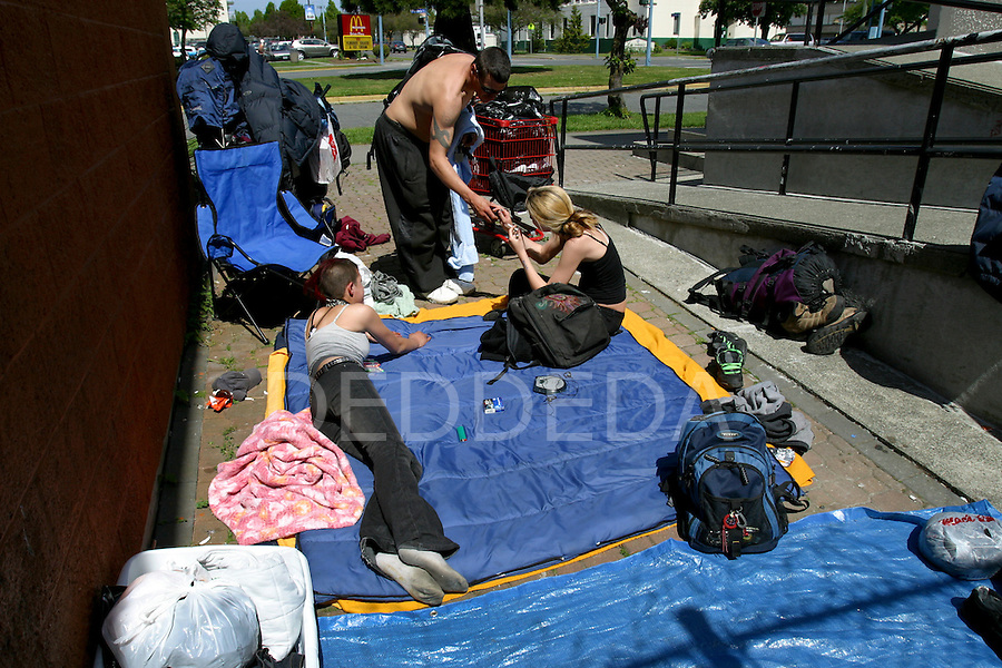 People make drug deals at one of the shooting galleries for intravenous drug-users in downtown Victoria, British Columbia, BC, Canada. Photo shot for the GLOBE and MAIL.