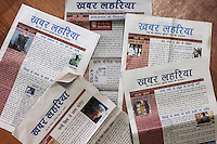 Different editions of Khabar Lahariya newspapers that is published in 6 different local language editions in the state of Uttar Pradesh strewn on the floor of a workshop room in Chitrakoot, Uttar Pradesh, India on 04 December 2012. During these workshops, editors from Khabar Lahariya's Nirantar NGO headquarters in Delhi come to spend the week with the regional and village-level journalists and editors to work on special report issues and fine-tune their skills for running their regional operations with minimal support from the main office. Photo by Suzanne Lee / Marie Claire France