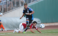 Javier Robles (30) kicks the ball ahead of Carlos Borja. The San Jose Earthquakes defeated Chivas USA 6-5 in shootout after drawing 0-0 in regulation time to win the inagural Sacramento Cup at Raley Field in Sacramento, California on June 12, 2010.