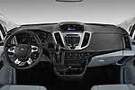 Stock photo of straight dashboard view of a 2019 Ford Transit Wagon 350 XLT Wagon Med Roof Sliding Pass. 148 5 Door Passenger Van