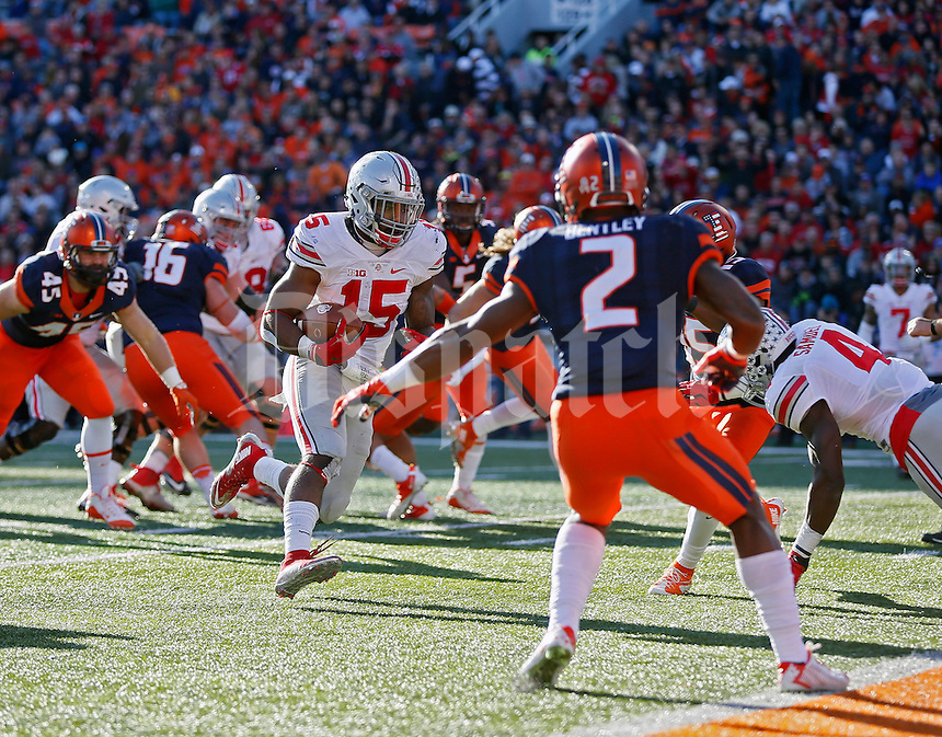 Ohio State Buckeyes running back Ezekiel Elliott (15) scores a rushing touchdown against Illinois Fighting Illini defense in the second half of their game at Memorial Stadium in Champaign, IL on November 14, 2015.  (Dispatch photo by Kyle Robertson)