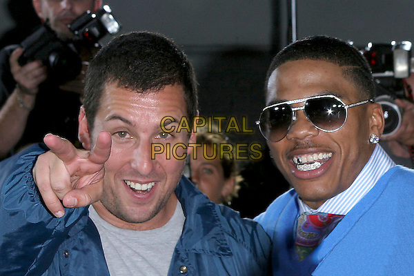 "ADAM SANDLER & NELLY.World Premiere of ""The Longest Yard"" held at Grauman's Chinese Theatre..May 19th, 2005.Photo Credit: Jacqui Wong/AdMedia.headshot portrait pointing gesture sunglasses shades teeth.www.capitalpictures.com.sales@capitalpictures.com.© Capital Pictures."