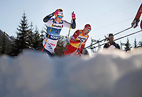 1st January 2020, Toblach, South Tyrol , Italy;  Sergey Ustiugov of Russia and Calle Halfvarsson of Sweden competes in the mens 15 km classic technique pursuit during Tour de Ski on January 1, 2020 in Toblach.