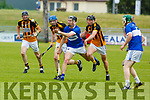 Cian Hussey of St Brendans about to off load the sliotar as Abbeydorney players bare down on him, in R2 of the Senior Hurling Championship in Austin Stack Park on Sunday.