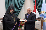 Palestinian President Mahmoud Abbas receives an invitation to attend Christmas celebrations for the Armenian calendar in the West Bankc city of Ramallah, on January 5, 2020. Photo by Thaer Ganaim