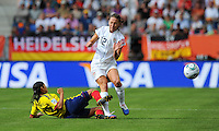 Lauren Cheney (r) of team USA and Yulieht Dominguez of team Colombia during the FIFA Women's World Cup at the FIFA Stadium in Sinsheim, Germany on July 2nd, 2011.