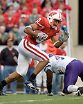 MADISON, WI - SEPTEMBER 9: Tight end Travis Beckum #9 of the Wisconsin Badgers gains yardage after a reception against the Western Illinois Leathernecks at Camp Randall Stadium on September 9, 2006 in Madison, Wisconsin. The Badgers beat the Leathernecks 34-10. (Photo by David Stluka)