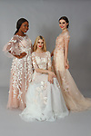 Abby Awokere - Chief Operating Officer (left) poses with models for the Chelsea Liu bridal fashion presentation in LEEZ department store at 37 Trinity Place in New York City on October 7, 2017; during New York Bridal Fashion Week Spring 2018.