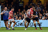Ed Slater of Gloucester Rugby is double-tackled by Sam Underhill and Elliott Stooke of Bath Rugby. Gallagher Premiership match, between Bath Rugby and Gloucester Rugby on September 8, 2018 at the Recreation Ground in Bath, England. Photo by: Patrick Khachfe / Onside Images
