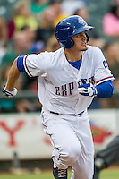 Round Rock Express second baseman Brent Lillibridge (18) runs to first base during the Pacific Coast League baseball game against the Oklahoma City RedHawks on August 1, 2014 at the Dell Diamond in Round Rock, Texas. The Express defeated the RedHawks 6-5. (Andrew Woolley/Four Seam Images)